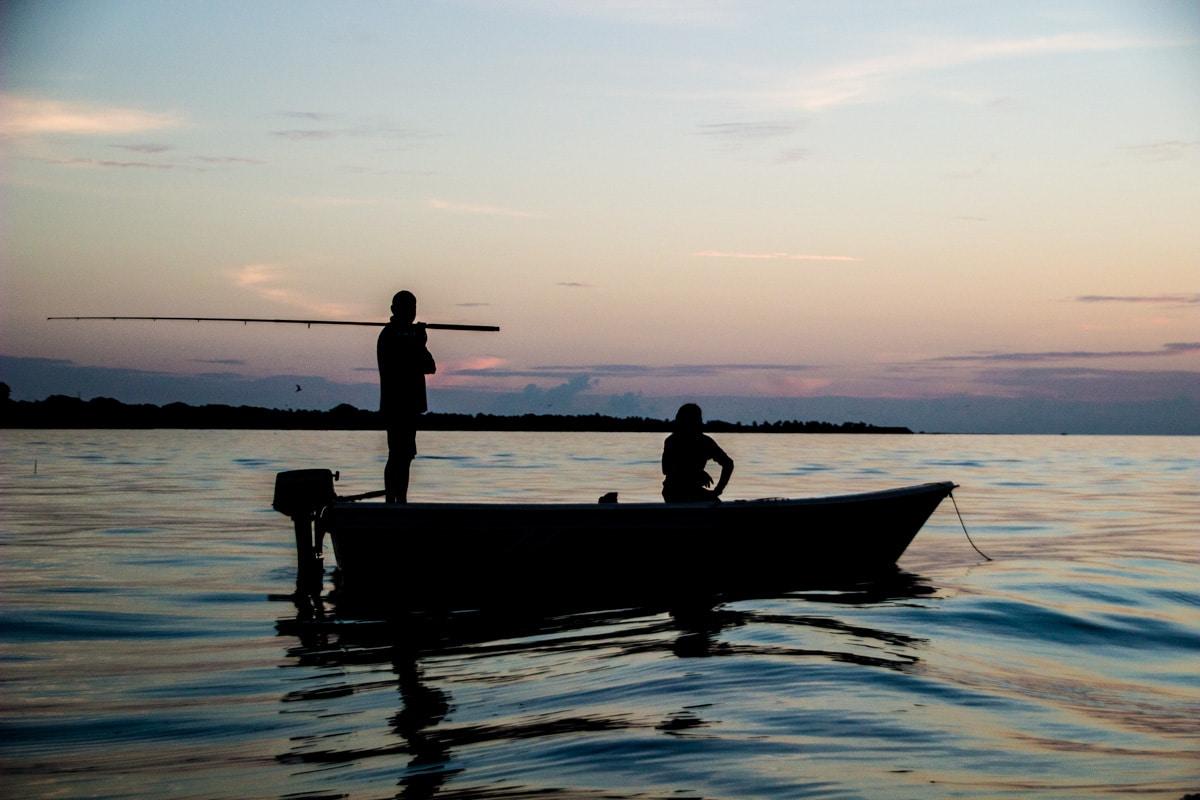 Fisherman during sunset in Rasdhoo - Maldives