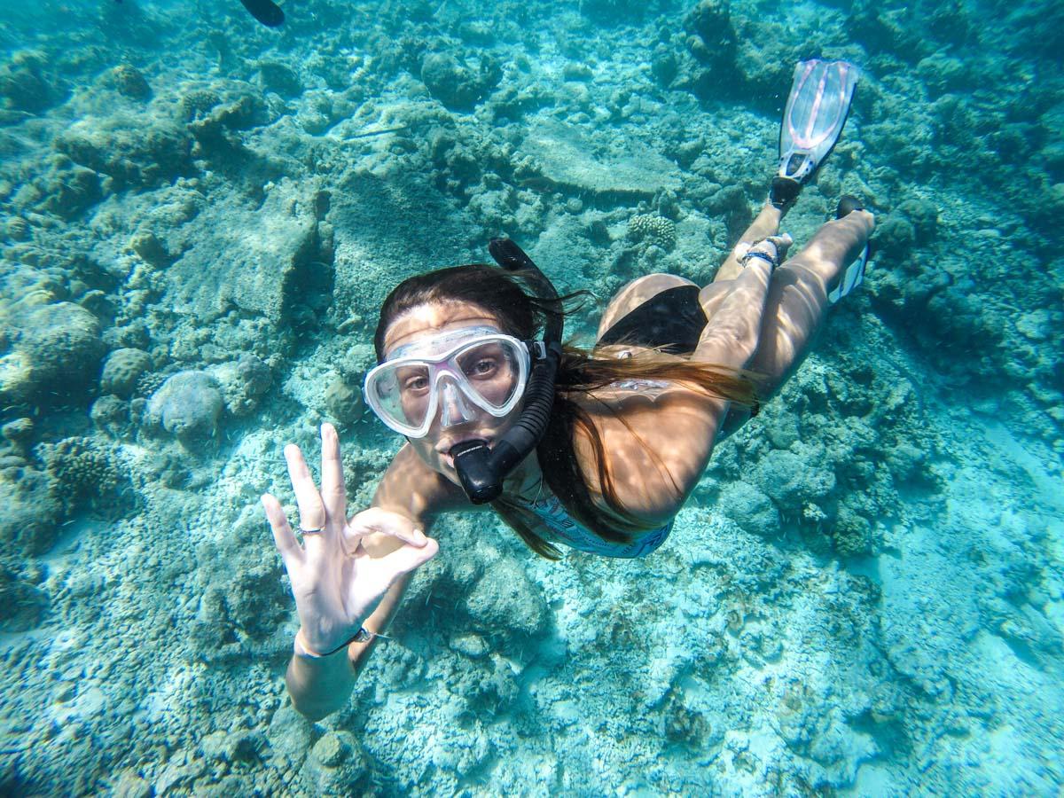 Woman Snorkeling in Rasdhoo Island - Maldives