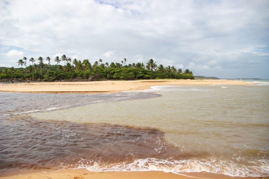 Caraíva River meeting the sea