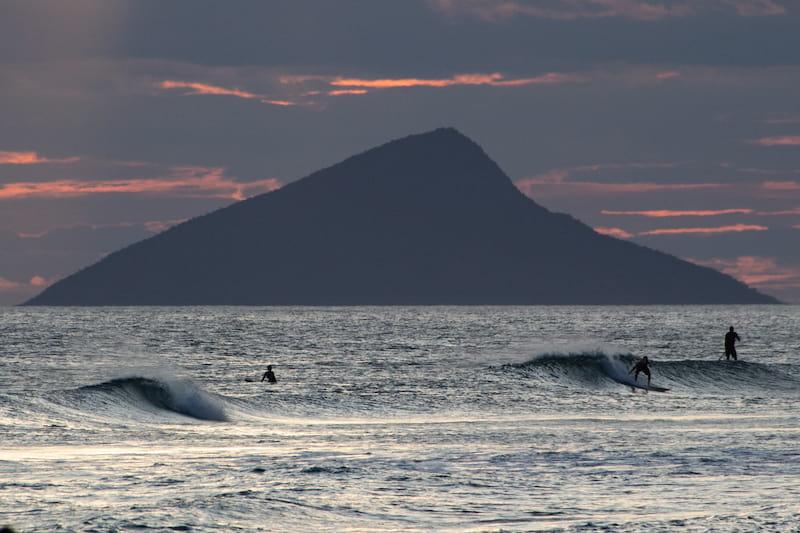 Surfers in Maresias beach - waves