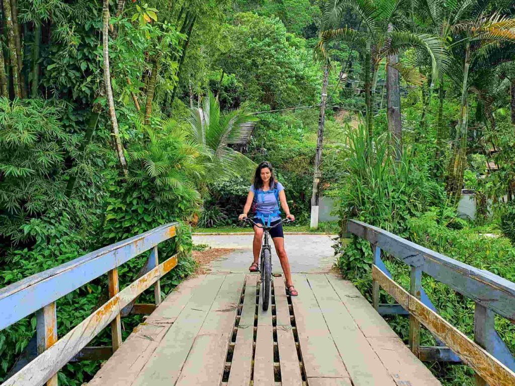 woman biking in the atlantic forest