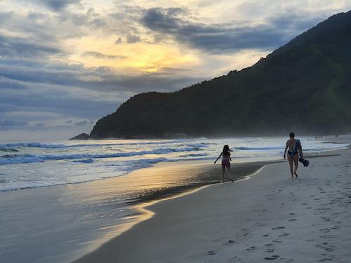 people walking at Maresias beach in Brazil