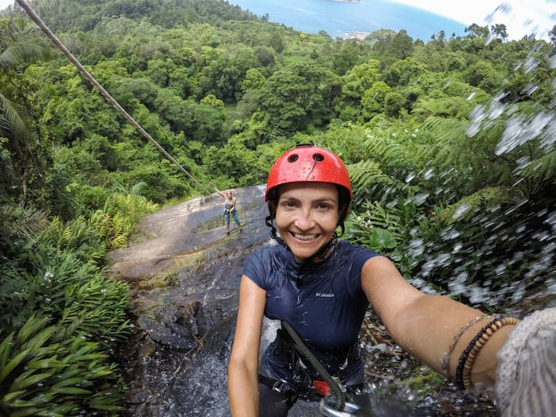 Elaine waterfall rappelling in Brazil