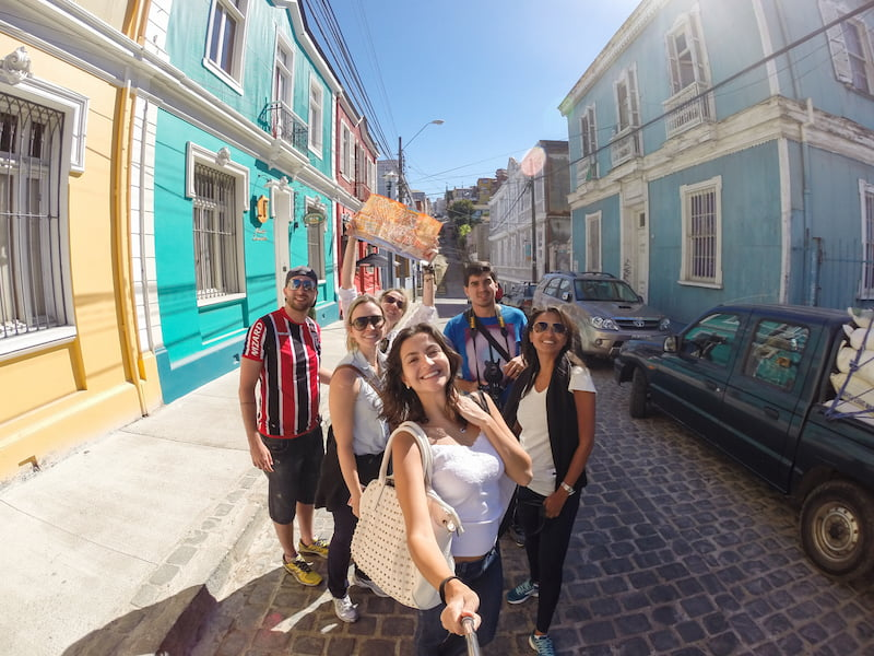 Elaine walking with friends on the streets of Valparaiso in Chile