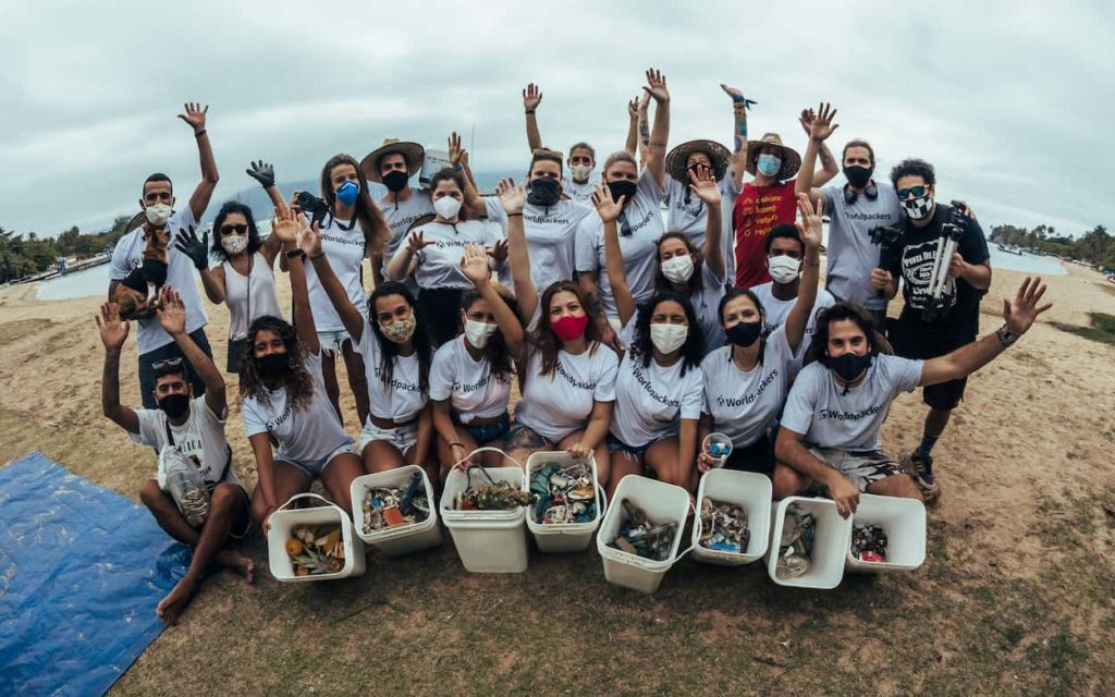 Volunteers during a beach clean-up organized by Worldpackers in Brazil
